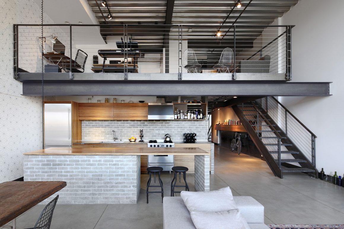 loft com estilo industrial, cozinha em living embaixo