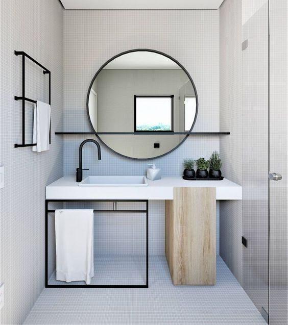 banheiro minimalista com pastilha branca e metais pretos