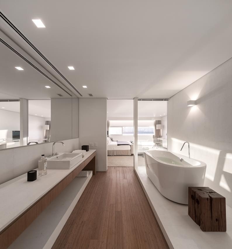 suíte minimalista projetada por arthur casas