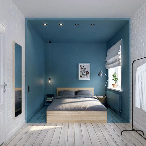 área de dormir delimitada por pintura nas paredes.