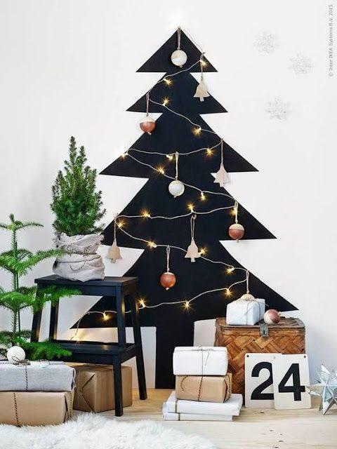 árvore de natal pintada na parede toda preta