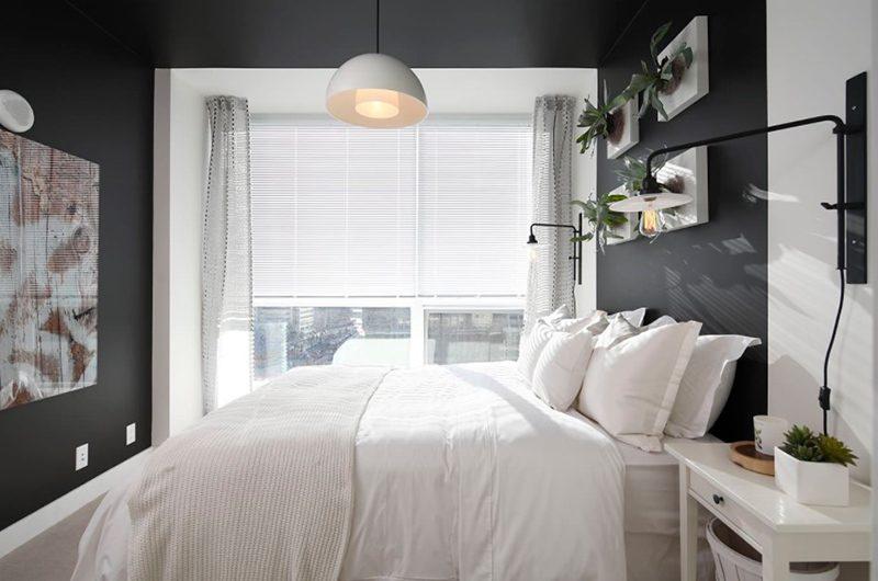quarto preto com cama branca