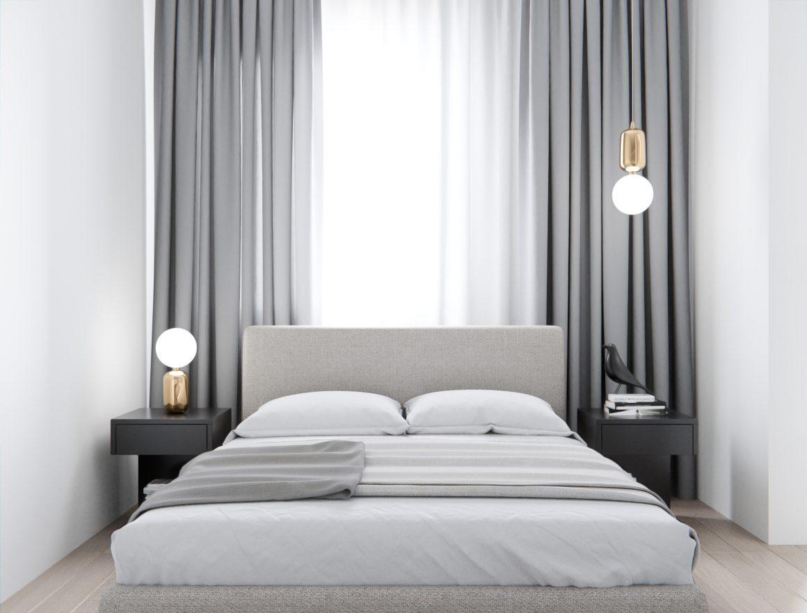 cama toda branca com manta cinza claro em cima