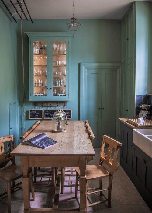 Cozinha verde escuro super contemporânea e elegante