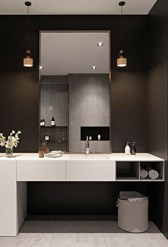 banheiro todo preto com marcenaria branca